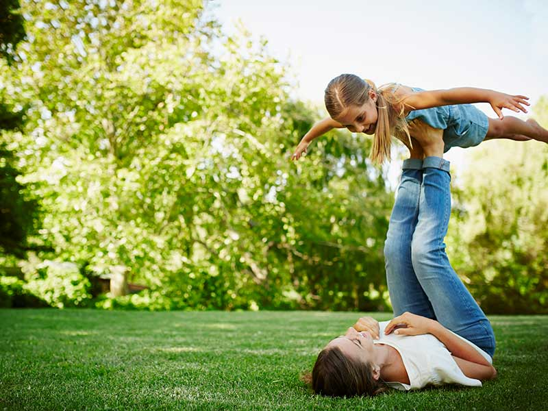 image of a mother and child playing on the lawn